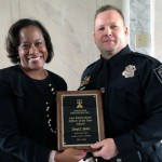 Sherry Boston presented the Officer Of The Year award to Officer Darryl L. Yarbro